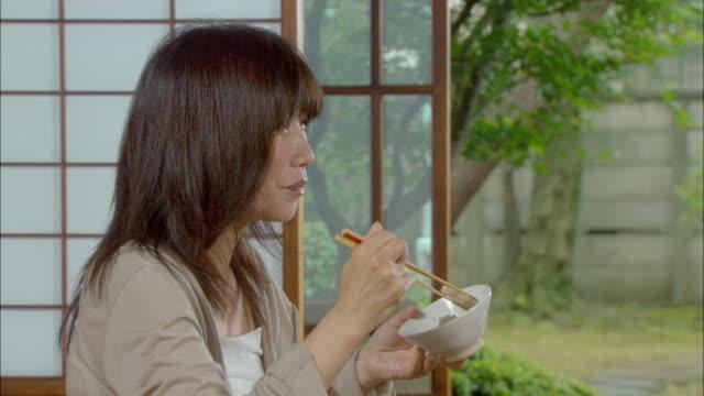 CU Mature woman eating/ Tokyo, Japan