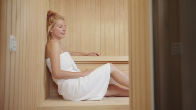 mature woman enjoying in the sauna - sauna stock videos and b-roll footage