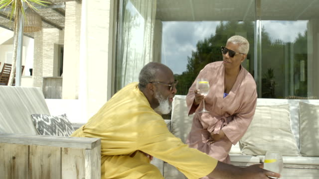 mature woman exits sunny villa - bathrobe stock videos & royalty-free footage