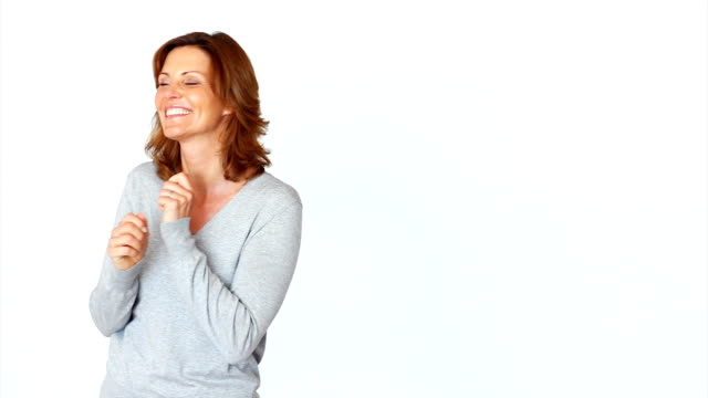 Mature woman expressing positivity