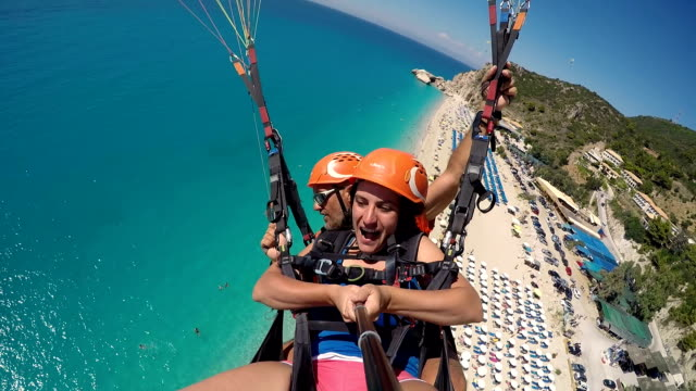 mature woman first time on paragliding.for excitement is never too late!! - parachute stock videos & royalty-free footage