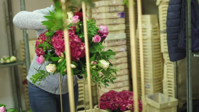 mature woman florist working in flower workshop - flower arrangement stock videos & royalty-free footage