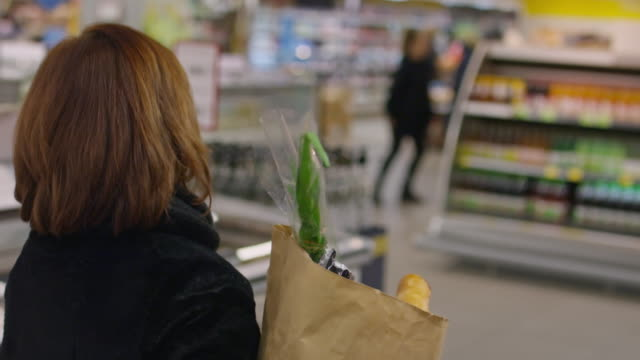 mature woman grocery with paper bag in supermarket - paper bag stock videos & royalty-free footage