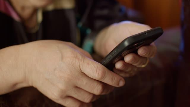 cu : mature woman hand using smartphone - senior women stock videos & royalty-free footage