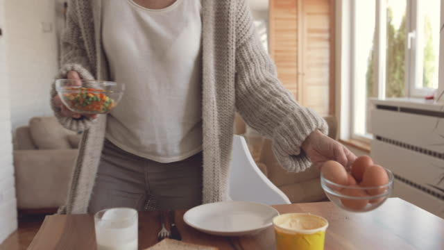 mature woman having breakfast and enjoying in a morning at home. - hard boiled egg stock videos & royalty-free footage