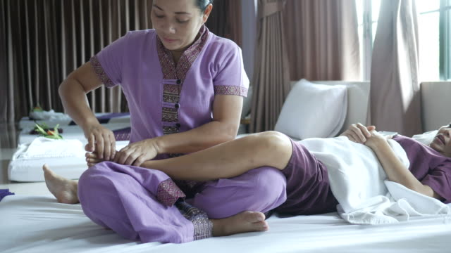 mature woman having relaxing  with thai massage - thai culture stock videos & royalty-free footage