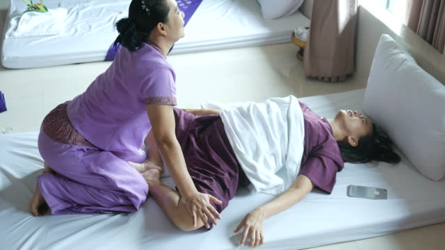 mature woman having relaxing with thai massage - mental health professional stock videos and b-roll footage