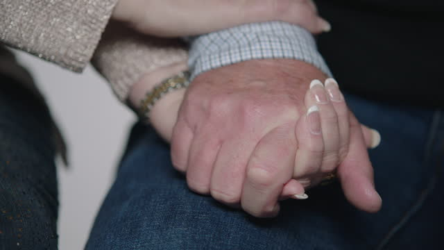 cu slo mo. mature woman holds hands with husband and strokes his hand in slow motion. - french manicure stock videos and b-roll footage