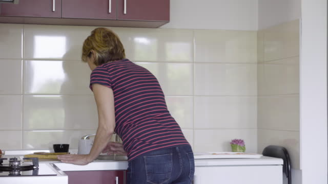 mature woman in backache - uncomfortable stock videos and b-roll footage