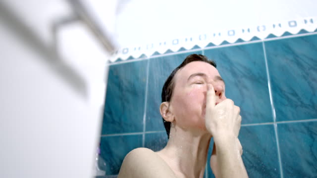 a mature woman is taking a shower - one mature woman only stock videos & royalty-free footage
