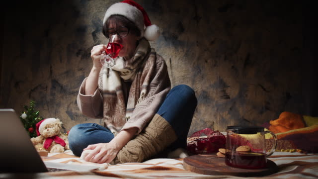 mature woman is wishing a merry christmas to her friends and relatives all around the world - only mature women stock videos & royalty-free footage