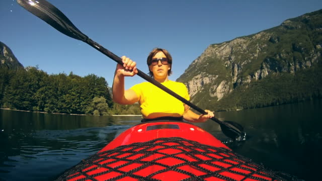 hd slow-motion: mature woman kayaking. - using a paddle stock videos & royalty-free footage