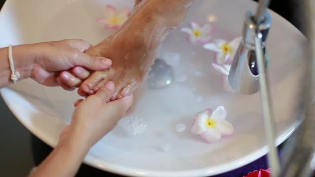 mature woman make foot spa