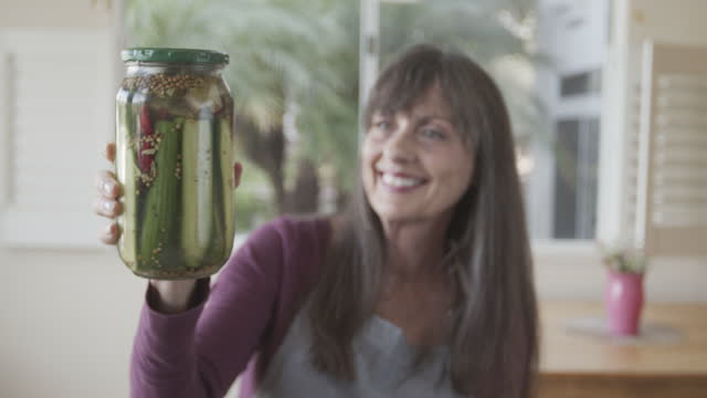 mature woman making homemade pickles at home - day stock videos & royalty-free footage