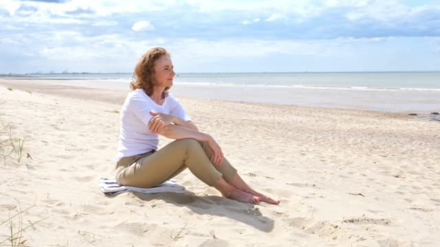 mature woman on the beach - belgium stock videos & royalty-free footage
