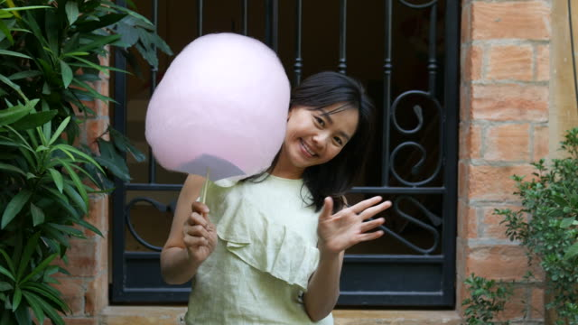 mature woman play peekaboo game with cotton candy - peekaboo game stock videos & royalty-free footage