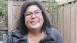 Mature woman posing looking at the camera smiling (real latino women)