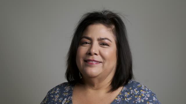 mature woman posing looking at the camera smiling (real latino women) - brown hair stock videos & royalty-free footage