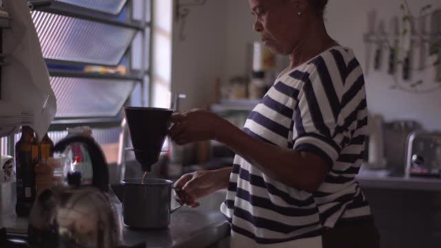 mature woman preparing coffee at home - coffee break stock videos & royalty-free footage