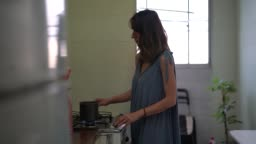 Mature Woman Preparing Coffee In The Kitchen