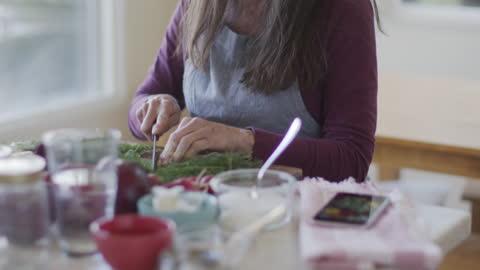 vídeos y material grabado en eventos de stock de mature woman preserving vegetables at home - one mature woman only