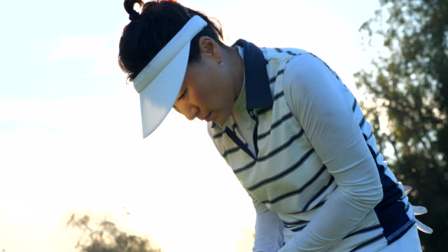 cu mature woman putting during early morning round of golf - balance stock videos & royalty-free footage