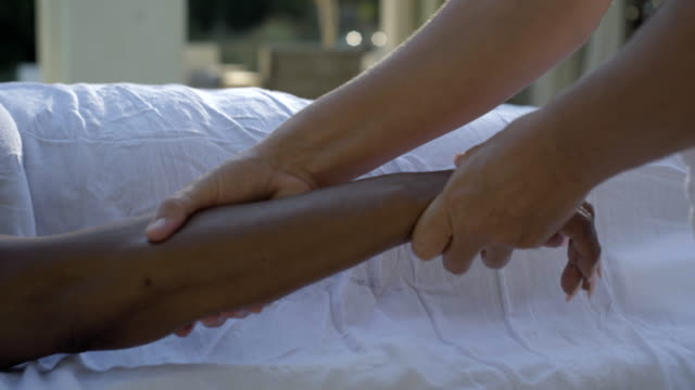 mature woman receives arm and hand massage - masseur stock videos & royalty-free footage
