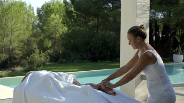 mature woman receives massage - masseur stock videos & royalty-free footage