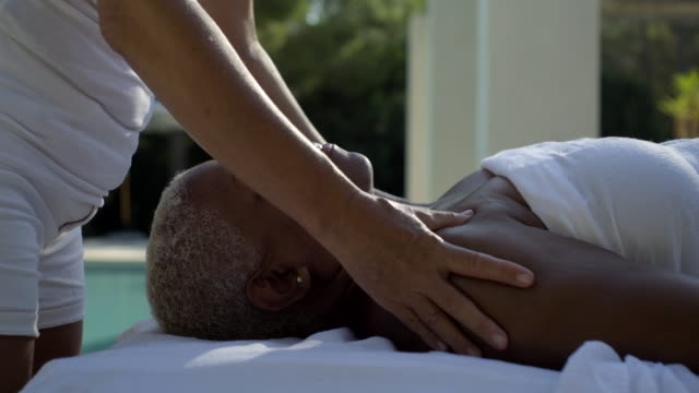 mature woman receives upper body massage - masseur stock videos & royalty-free footage