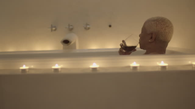 mature woman relaxes in the bath - solitude stock videos & royalty-free footage