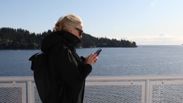 mature woman relaxes on deck on ferry boat - ferry deck stock videos & royalty-free footage