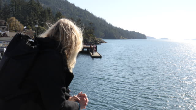 mature woman relaxes on ferry boat - one mature woman only stock videos & royalty-free footage
