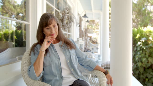 ms mature woman relaxing at home - veranda stock videos & royalty-free footage