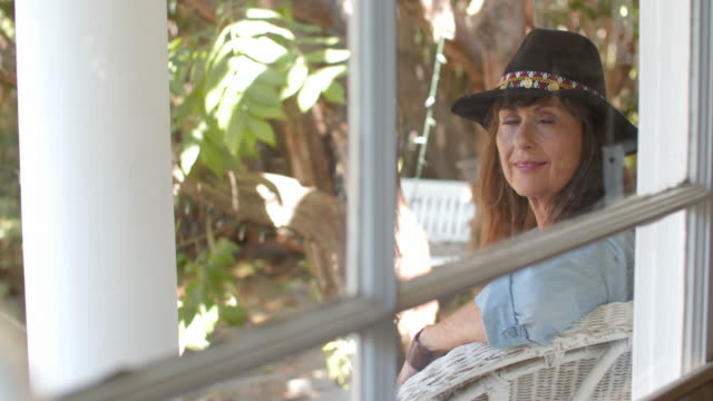 mature woman relaxing at home - cowboy hat stock videos & royalty-free footage