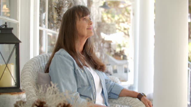 mature woman relaxing on a front porch - domestic garden stock videos & royalty-free footage