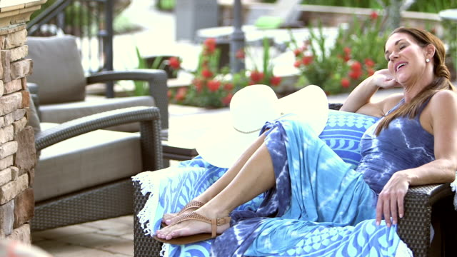 Mature woman relaxing on patio