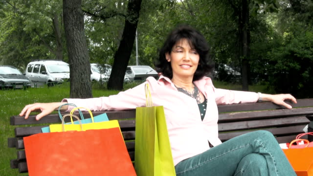mature woman relaxing - brown hair stock videos & royalty-free footage