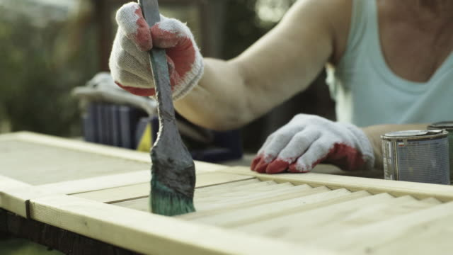 mature woman renovate old furniture - focus stock videos & royalty-free footage