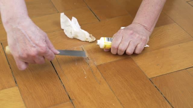mature woman repairing parquet floor - mature women stock videos & royalty-free footage