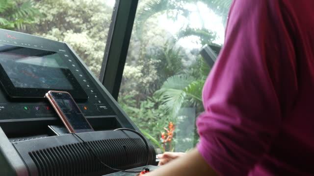 mature woman running on treadmill - treadmill stock videos and b-roll footage