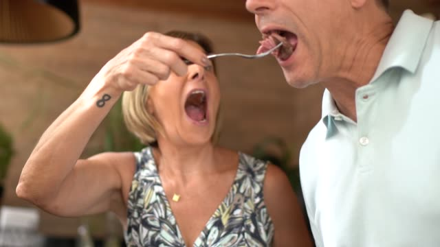mature woman serving meat to man during barbecue - eating stock videos & royalty-free footage