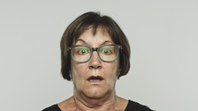 mature woman shocked - pulling funny faces stock videos & royalty-free footage