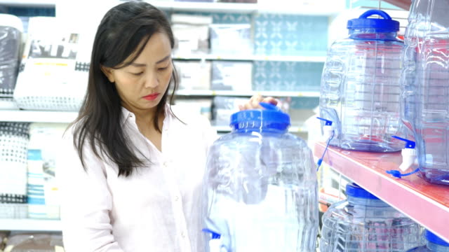 Mature woman shopping in department store , household product