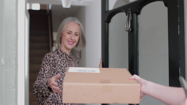 mature woman signing for a home delivery - receiving stock videos & royalty-free footage