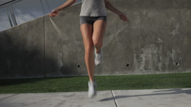 la mature woman skipping with jump rope outdoors. - footwear stock videos & royalty-free footage