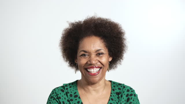 mature woman smiling to camera - white background stock videos & royalty-free footage