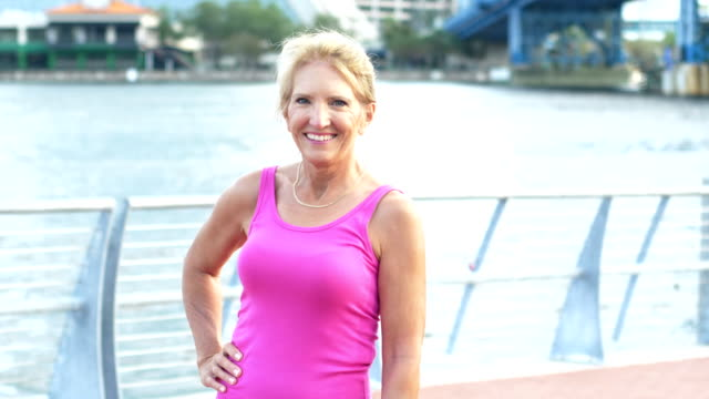 mature woman standing on waterfront - vest stock videos & royalty-free footage