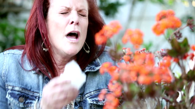 mature woman suffering from allergies - hay fever stock videos and b-roll footage