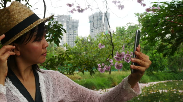 mature woman taking selfie with smart phone