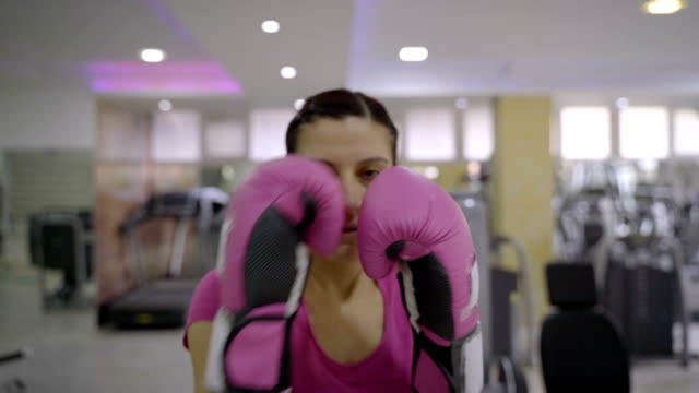 mature woman trains boxing at the gym - comment box stock videos & royalty-free footage